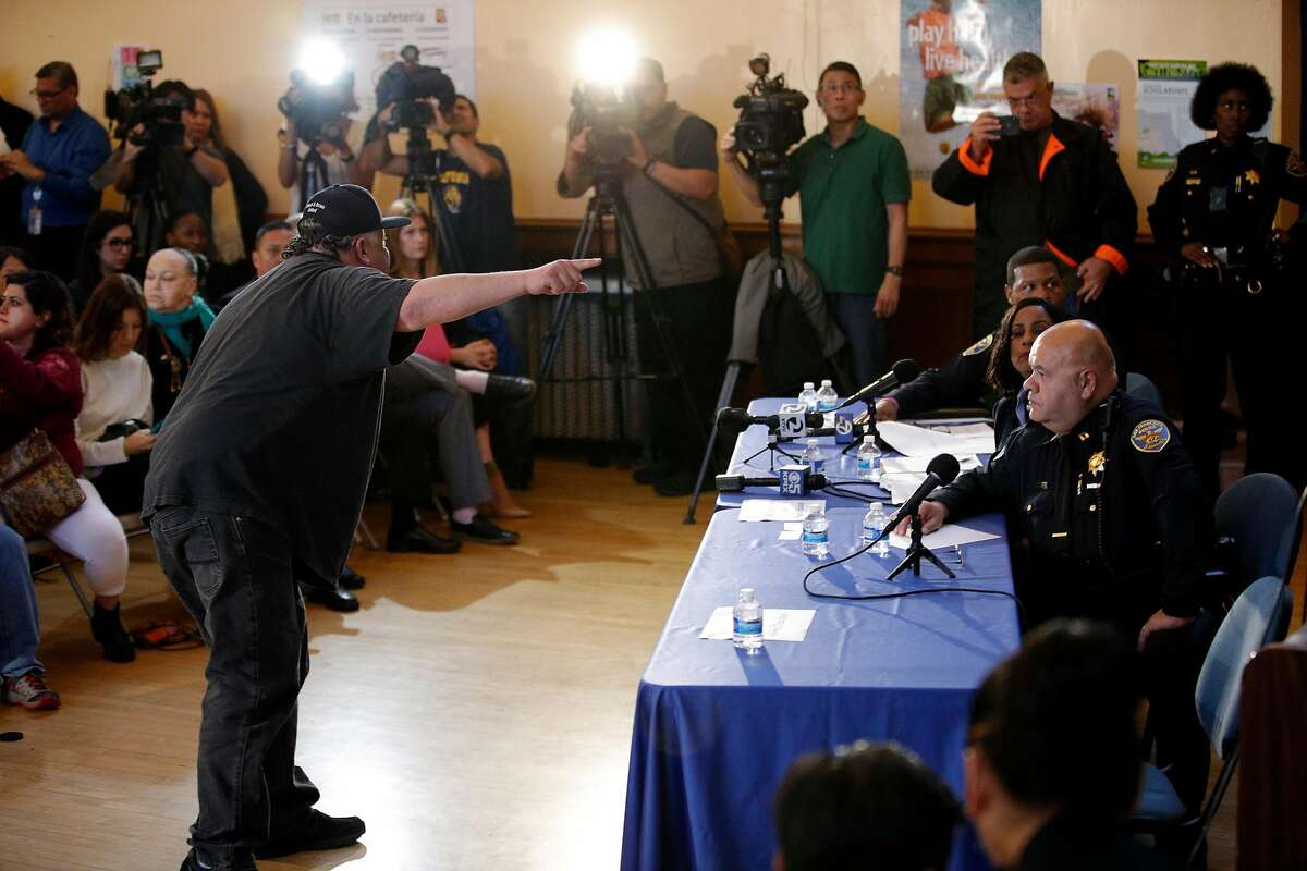 Victor Picazo gets up and yells at the police command staff during a townhall meeting with police to update the community on the investigation of the police involved shooting of Jesus Adolfo Delgado Duarte at Cesar Chavez School in San Francisco, Calif., on Monday, March 12, 2018.