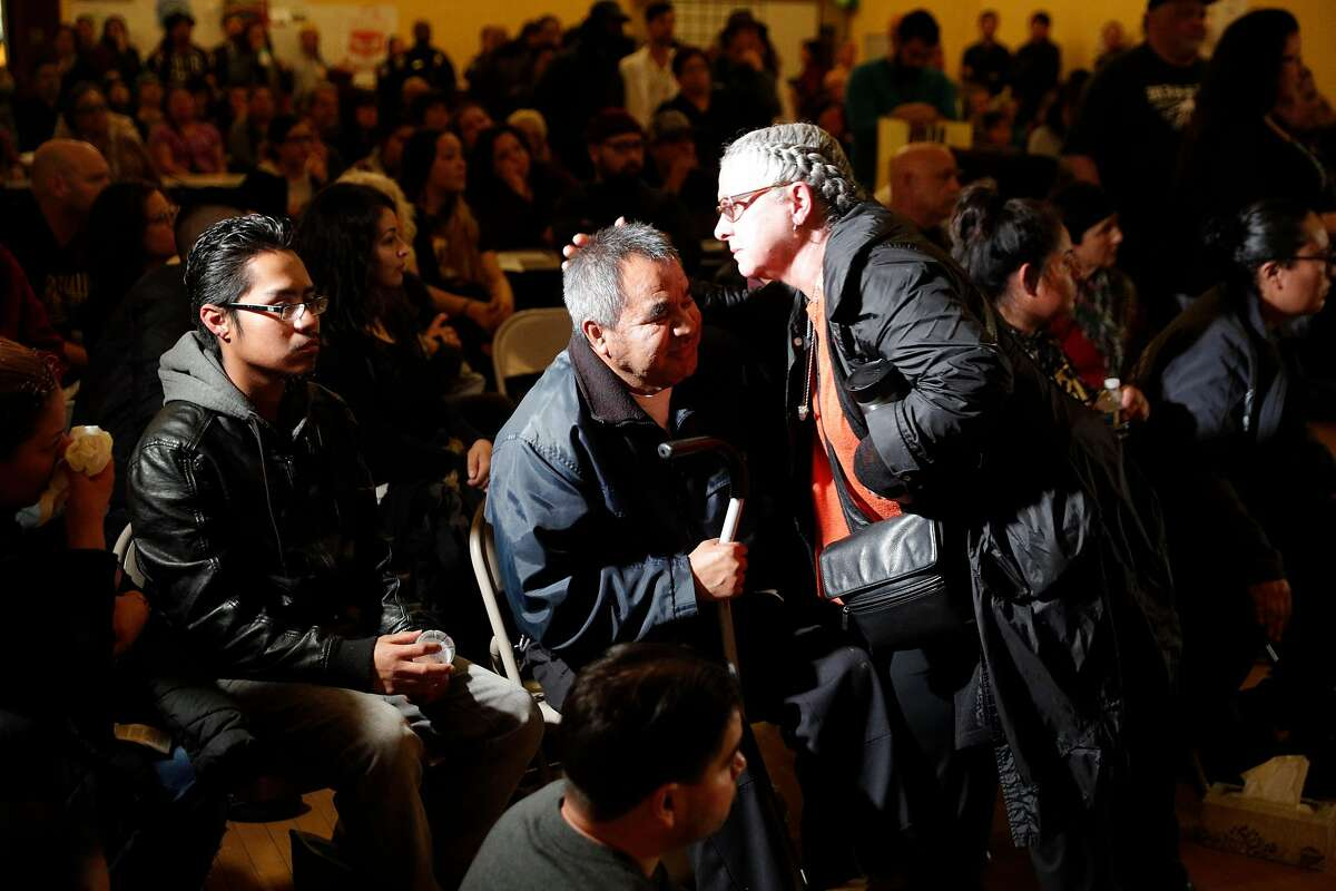 Gina Padilla hugs Jose Delgado, the father of Jesus Adolfo Delgado Duarte during a townhall meeting with police to update the community on the investigation of the police involved shooting of Delgado Duarte at Cesar Chavez School in San Francisco, Calif., on Monday, March 12, 2018.