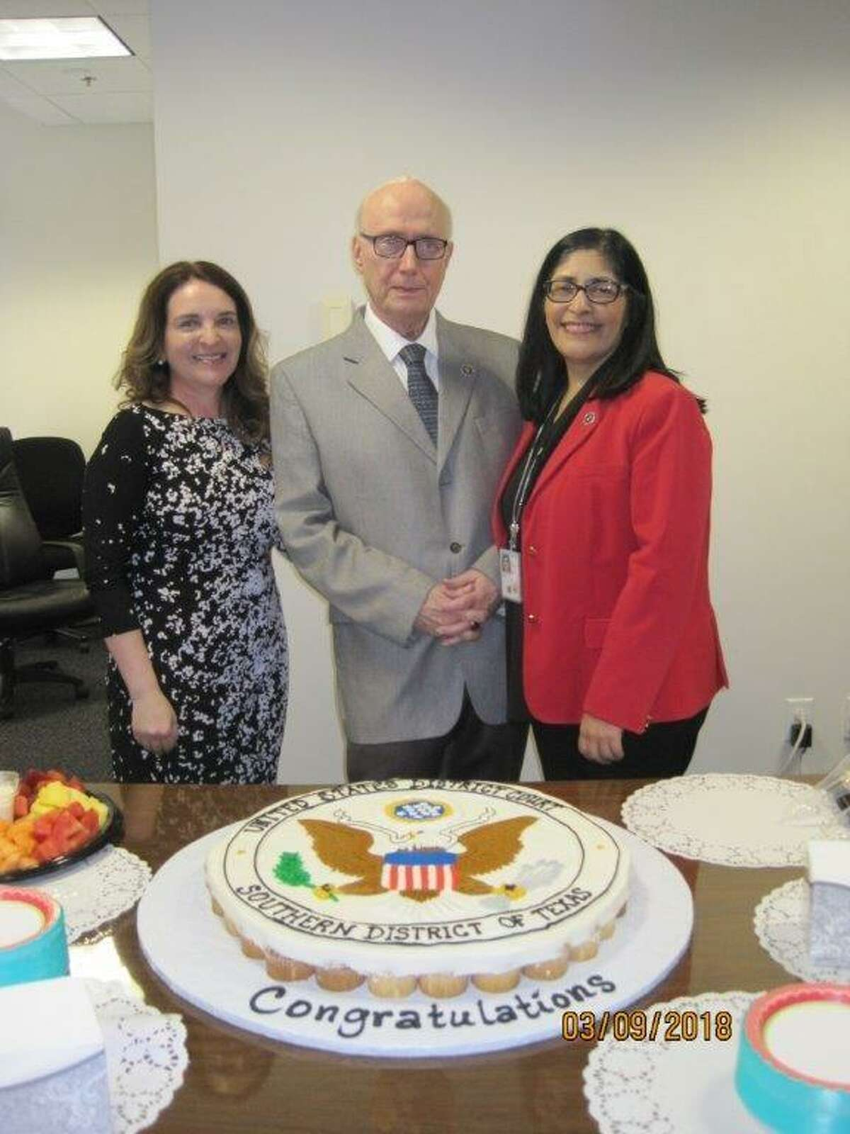 U.S. district judges Marina Garcia Marmolejo, left, and Diana Saldaña pose for a photo with Senior U.S. District Court Judge George P. Kazen at his retirement party on Friday.