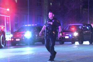 The man opened fire on the woman just before 11 p.m. at a condominium complex in the 1800 block of Broadway Street.