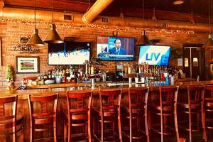 A 'Cheers'-like atmosphere and great ciopinno make customers feel at home at Ridgefield's Hideaway.