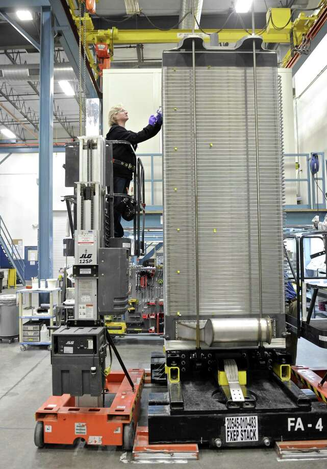 Janet Hixson completes the work on a 400 cell fuel cell stack at the FuelCell Energy manufacturing plant in Torrington, Conn. Wednesday, February 1, 2017. Photo: H John Voorhees III / Hearst Connecticut Media / The News-Times