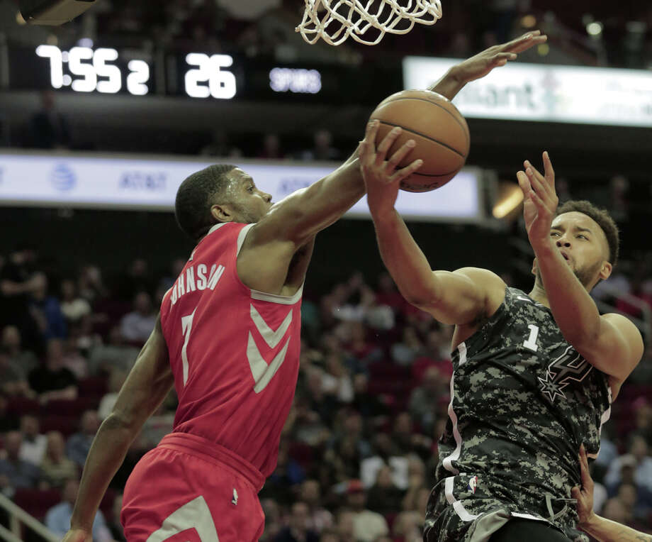 San Antonio Spurs forward Kyle Anderson (1) drives to the basket against Houston Rockets guard Joe Johnson (7) at the Toyota Center on Monday, March 12, 2018, in Houston. ( Elizabeth Conley / Houston Chronicle ) Photo: Elizabeth Conley/Houston Chronicle
