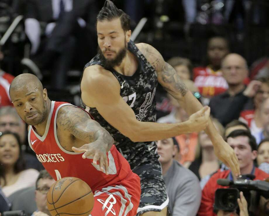 Houston Rockets forward PJ Tucker (4) steals the ball in front of San Antonio Spurs center Joffrey Lauvergne (77) at the Toyota Center on Monday, March 12, 2018, in Houston. Rockets won the game 109-93. ( Elizabeth Conley / Houston Chronicle ) Photo: Elizabeth Conley/Houston Chronicle
