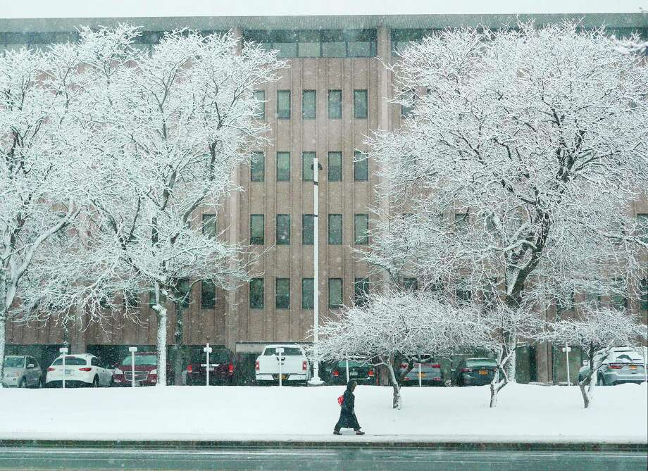 A woman makes her way along Wolf Road as snow falls on Tuesday, March 13, 2018, in Albany, N.Y.     (Paul Buckowski/Times Union) Photo: STAFF, Albany Times Union / (Paul Buckowski/Times Union)