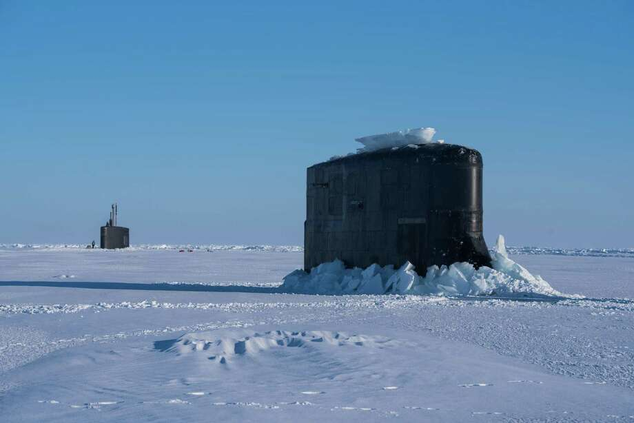 Seawolf-class submarine USS Connecticut and Los Angeles-class fast-attack submarine USS Hartford break through the ice on Friday March 9, 2018 in support of Ice Exercise 2018. ICEX 2018 is a five-week exercise that allows the Navy to assess its operational readiness in the Arctic, increase experience in the region, advance understanding of the Arctic environment, and continue to develop relationships with other services, allies and partner organizations. Photo: Petty Officer 2nd Class Michael / Commander Submarine Forces Pacific / Public Domain