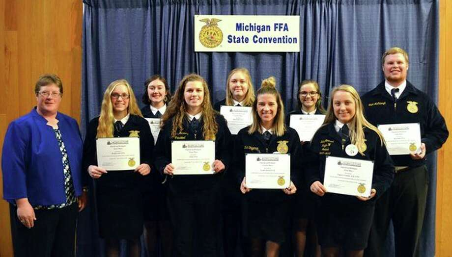 Eight FFA Chapters received #SpeakAgMichigan awards sponsored by the Michigan Foundation for Agriculture during the 90th Michigan FFA State Convention. MFB District 5 Director Stephanie Schafer presented awards to the following chapters: (Back row from left) Graceyn Newland, Springport FFA; Kourtney Cole, Montcalm FFA; Mackenzie Good, Alma FFA; Caleb McCullough, Ravenna FFA; (front, from left) MaKayla Smith, Webberville FFA; Bethany Gornowicz, Ubly FFA; Faith Yageman North Huron FFA; and Hailey Moenaert, Lapeer County A.M. FFA. (Submitted Photo)