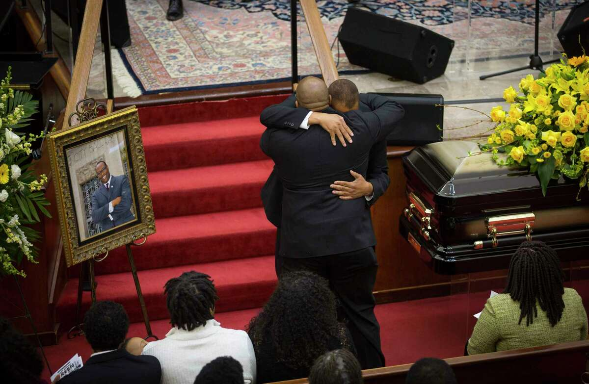 David Green (front), Councilman Green's brother, hugs Darnell Prejean after Prejean sang the Lord's Prayer during a celebration of life service for Houston City Councilman Larry Vincent Green at Brentwood Baptist Church, Monday, March 12, 2018, in Houston.
