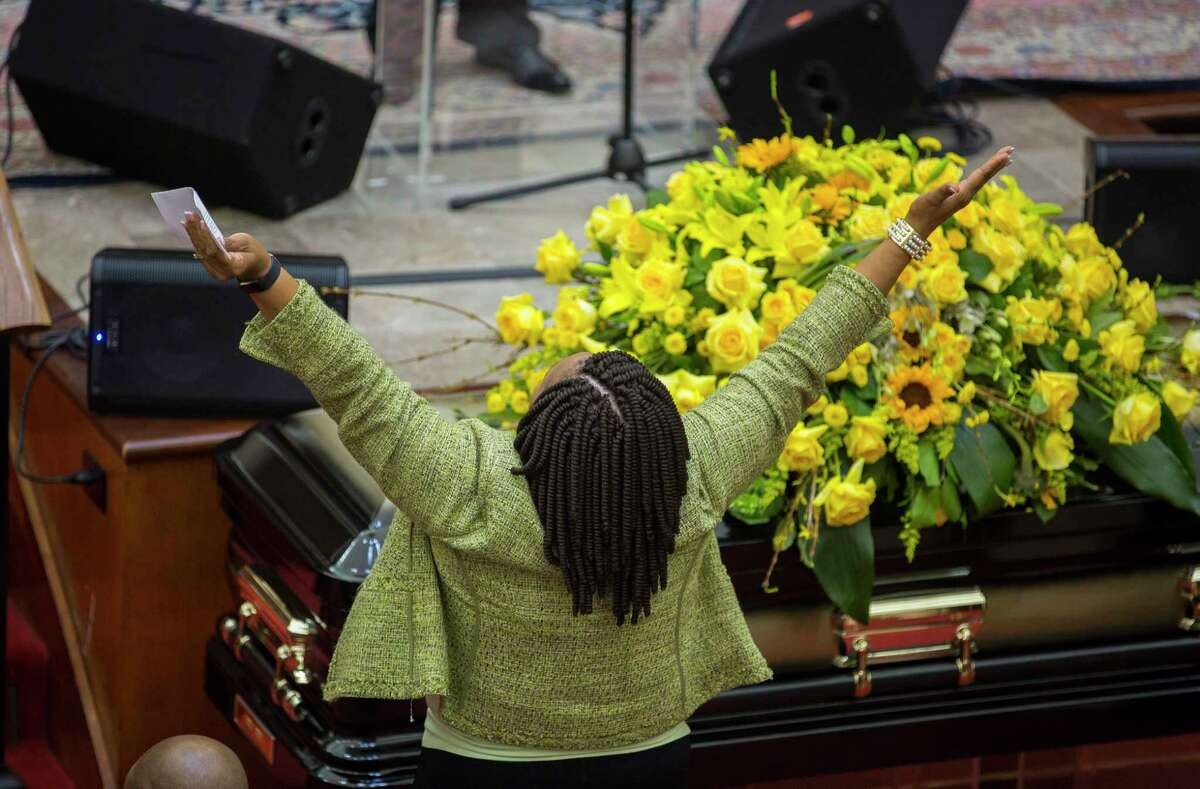 Christine Sampson Willie, a cousin of Councilman Green, stands up during a worship song during a celebration of life service for Houston City Councilman Larry Vincent Green at Brentwood Baptist Church, Monday, March 12, 2018, in Houston.