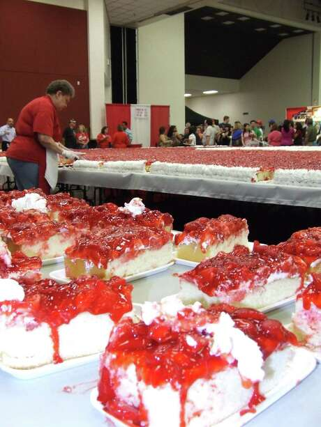 An annual tradition at the Pasadena Strawberry Festival is a giant strawberry shortcake that provides enough slices to feed a small army. Photo: Jeri Martinez / The Citizen