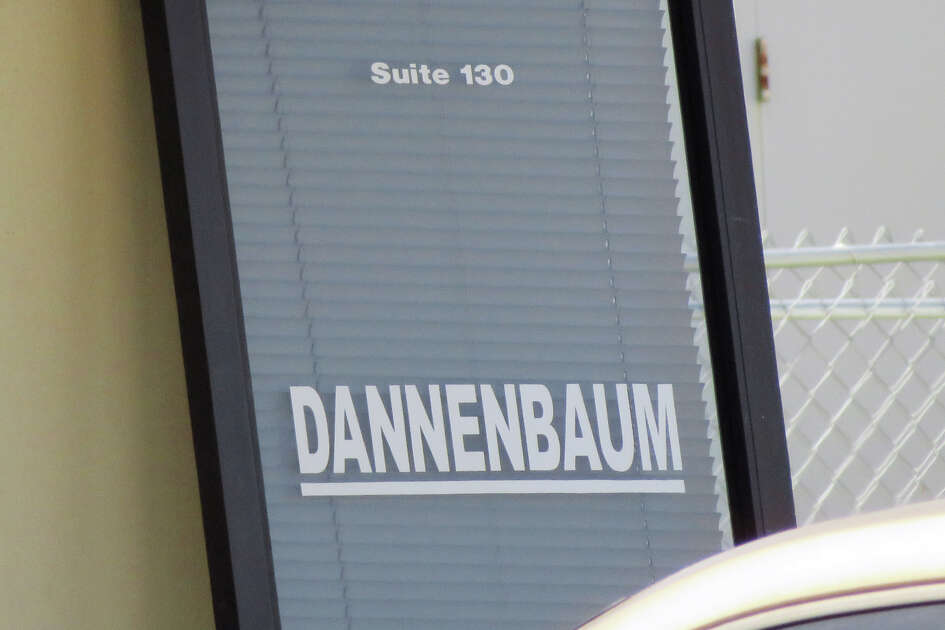 The front door to the Dannenbaum Engineering offices at 8610 McPherson Road Suite 130, was completely removed as FBI and Texas Department of Public Safety personnel conducted an investigation, Wednesday, April 26, 2017.
