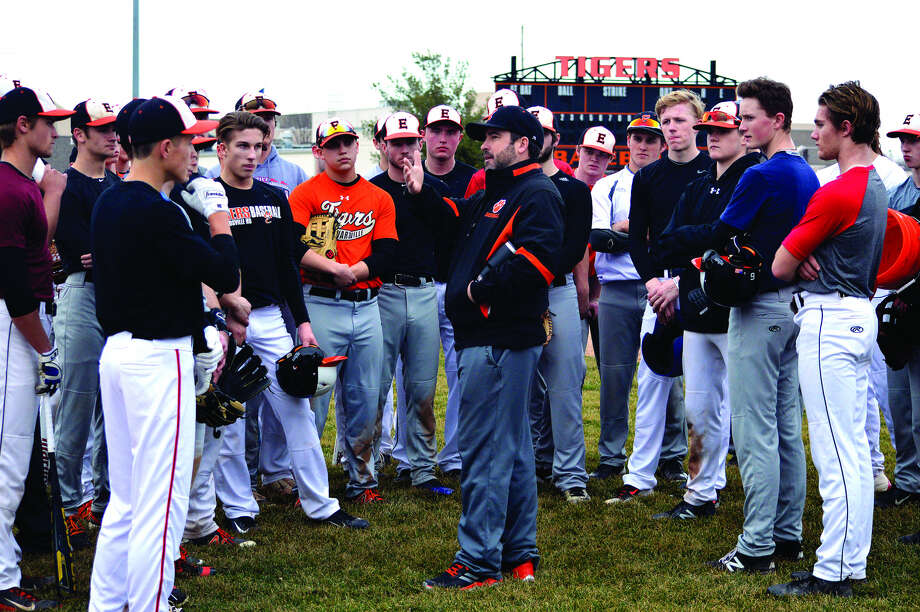 Edwardsville coach Tim Funkhouser, center, talks to his players after a practice earlier in March. The Tigers will open the 2018 season at home against Columbia at 7 p.m. Thursday at Tom Pile Field. EHS finished second at last year's state tournament.