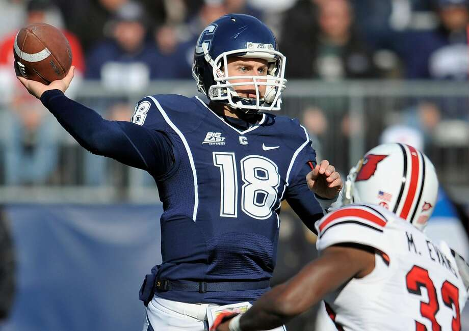 Connecticut's Johnny McEntee throws against Louisville's Mike Evans in the first half of an NCAA college football game at Rentschler Field in East Hartford, Conn., Saturday, Nov. 19, 2011.  Louisville beat Connecticut 34-20. (AP Photo/Jessica Hill) Photo: Jessica Hill, ASSOCIATED PRESS