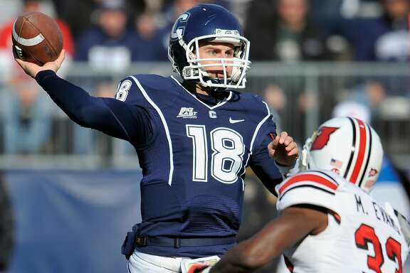 Connecticut's Johnny McEntee throws against Louisville's Mike Evans in the first half of an NCAA college football game at Rentschler Field in East Hartford, Conn., Saturday, Nov. 19, 2011.  Louisville beat Connecticut 34-20. (AP Photo/Jessica Hill)