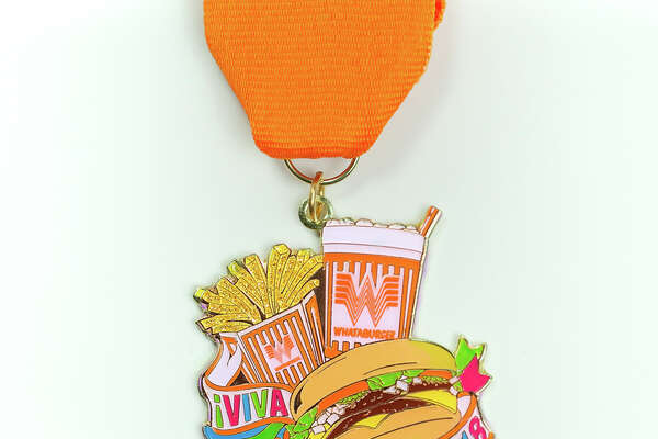 Texas' beloved burger chain is hosting a Fiesta Pop Up on Tuesday from 3 to 5 p.m., giving customers the chance to buy the restaurant's 2018 medal before anyone else, because if there's anything San Antonians are equally obsessed about, it's the 10-day party and the pin regalia that comes along with it.