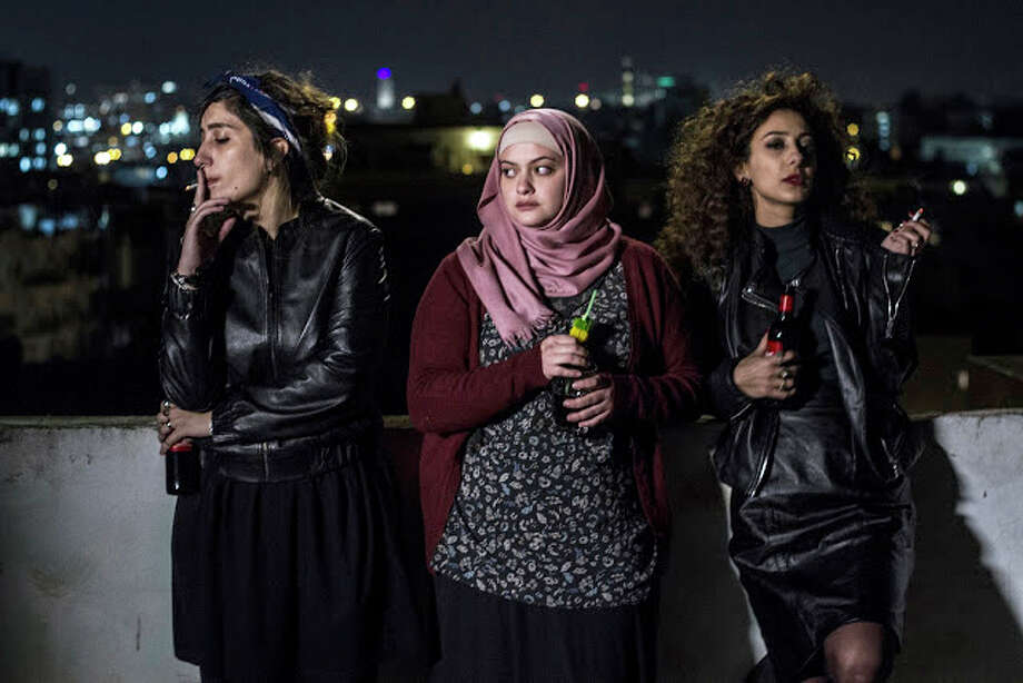 "(L-r) Mouna Hawa, Sana Jammelieh and Shaden Kanboura play Palestinian roommates sharing an apartment ub ""In Between."" Photo: Yaniv Berman, Film Movement / Film Movement-Yaniv Berman"