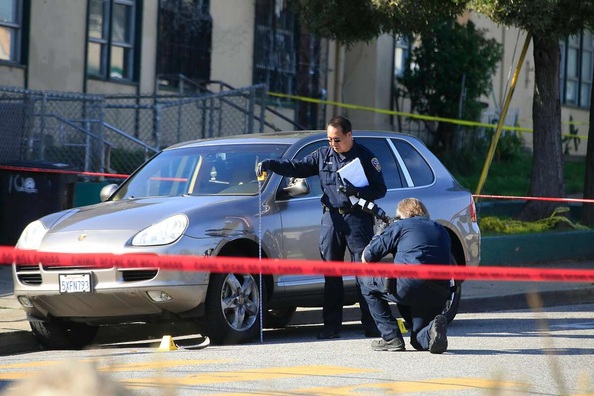 San Francisco Police investigate an officer involved shooting at the intersection of Fitzgerald Avenue and Griffith Street on Friday, December 1, 2017 in San Francisco, Calif.
