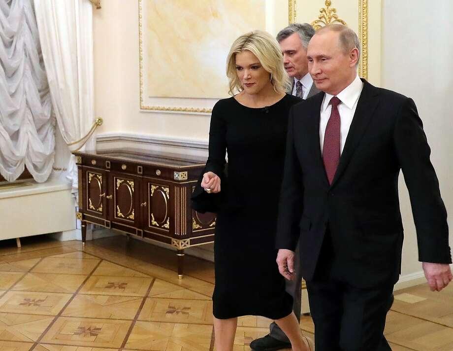 Megyn Kelly of NBC News walks with Russian President Vladimir Putin before their interview. Photo: Mikhail Klimentyev, Associated Press