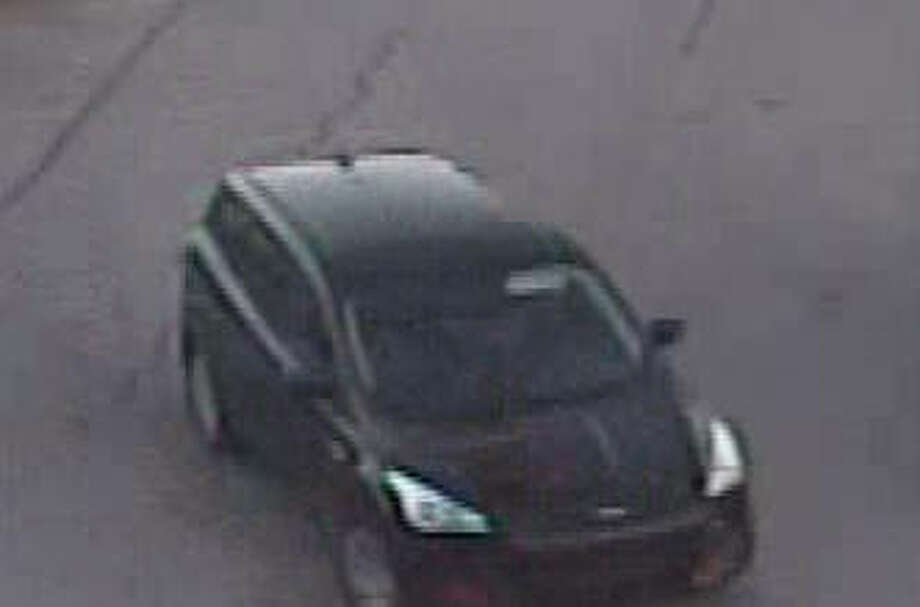 A surveillance photo of the suspect vehicle, a black, Ford four-door hatchback SUV. Photo: For The Telegraph
