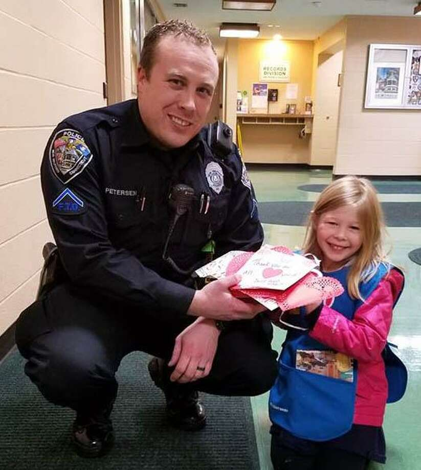 Emma Wellington delivers a care package to New Milford Police Officer David Petersen. Photo: Courtesy Of Daisy Troop 40067 / The News-Times Contributed