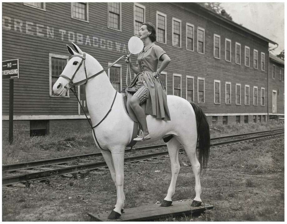 The New Milford Historical Society is celebrating a papier-mache horse, named Chief Waramaug Green, that has been in town for 100 years. It stood outside of Greens Warehouse on Bridge Street from 1918 until 1986. Photo: New Milford Historical Society / Contributed Photo / The News-Times Contributed