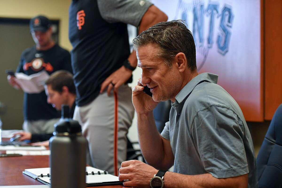 Scottsdale, AZ - March 8: David Bell of the San Francisco Giants takes a phone call at the Giants minor-league complex on March 8, 2018 in Scottsdale, Arizona.