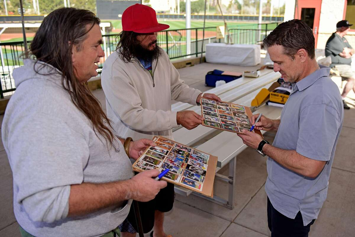 Scottsdale, AZ - March 8: David Bell of the San Francisco Giants signs baseball cards for fans at the Giants minor-league complex on March 8, 2018 in Scottsdale, Arizona.