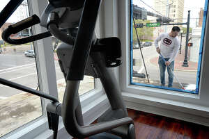Ibrahin Ramirez applies a coat of paint on the second floor overhang as work continues on the Downtown Fitness gym, which manager Dominique Roy aims to have open by the end of the month. The fitness facility offers two floors of cardio and strength-based workout machinery, as well as weights. Shower facilities are available in the locker rooms for those seeking a pre or mid-workday workout. The top floors of the former Dallas Williams Furniture Co. building will remain rentable storage units.  Gym hours will be 4:30 a.m. to 9 p.m. Monday through Friday and 9 a.m. to 6 p.m. Saturday. Membership begins at $45.00 per month, or $40.00 per month if signed for a year, and there is a $10.00 discount for police officers and students. Photo taken Thursday, March 8, 2018 Kim Brent/The Enterprise
