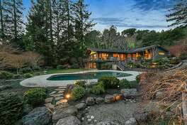 The Lafayette home features a 1.3-acre landscape with a Pebble Tec heated pool.