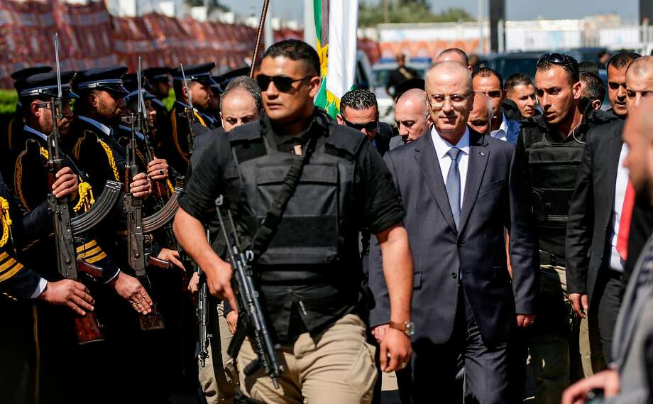 Palestinian Prime Minister Rami Hamdallah (2nd from right) is escorted by bodyguards in Gaza City. Photo: MAHMUD HAMS, AFP/Getty Images