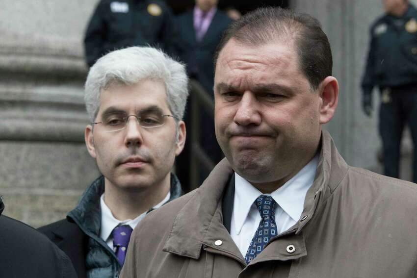 Joseph Percoco, right, former top aide to New York Gov. Andrew Cuomo, reacts while talking to reporters outside U.S. District court, Tuesday, March 13, 2018, in New York. Percoco was convicted on corruption charges Tuesday at a trial that further exposed the state capital's culture of backroom deal-making.