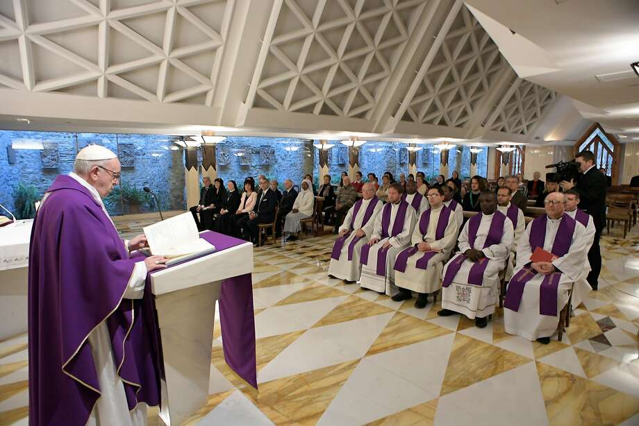 Pope Francis (left) celebrates Mass on Monday at the Vatican. Tuesday marks the fifth anniversary of the pontiff's election since the historic resignation of Pope Benedict XVI. Photo: Associated Press