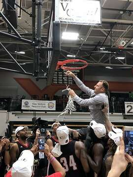 CCSF head coach Justin Labagh cuts down the net after Sunday's win over San Diego City College.