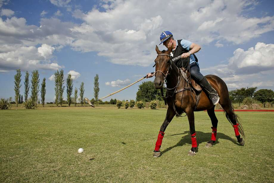 Martin Folan, a tourist from London, hits the ball during a polo practice at La Carona club in Buenos Aires province, Argentina. Photo: Victor R. Caivano, Associated Press