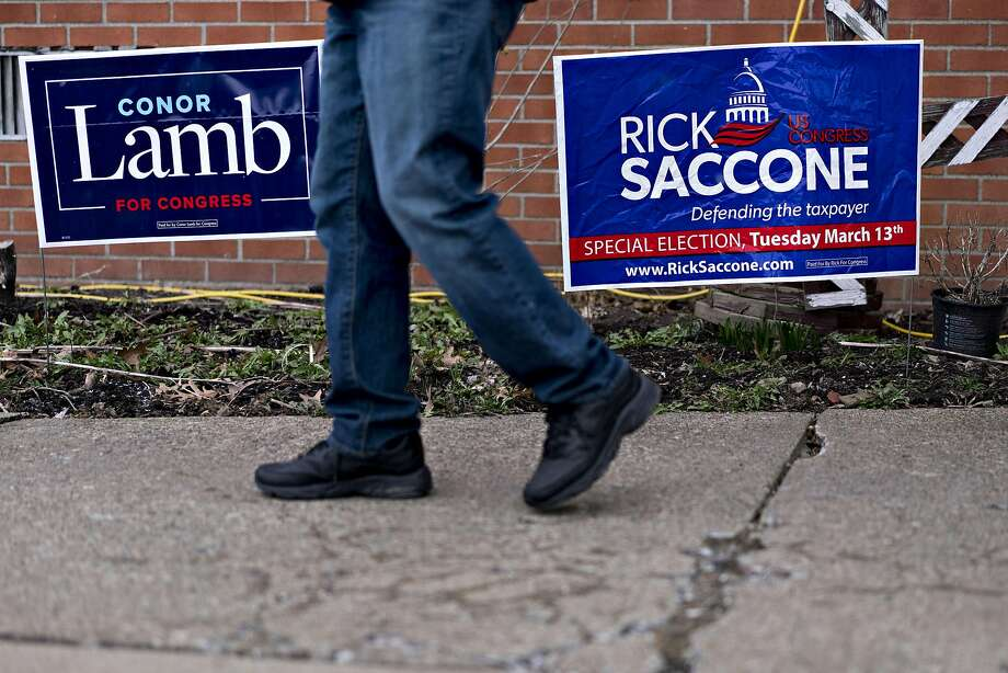 Campaign signs for the candidates for the House of Representatives are seen in Carnegie, Pa. Photo: Andrew Harrer, Bloomberg