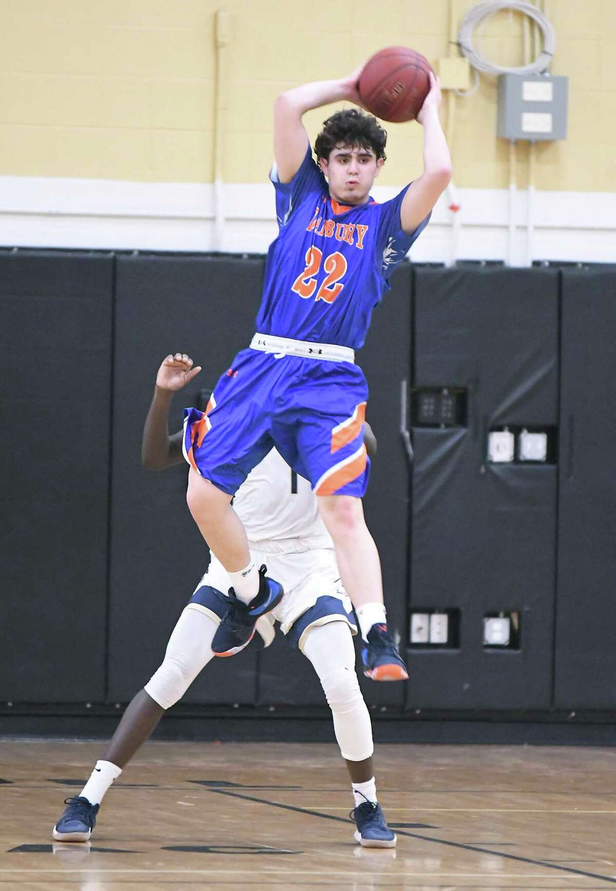Danbury's Cameron Snow looks to make a pass during the Division I boys basketball quarterfinals against Notre Dame-Fairfield at Trumbull High on Monday.