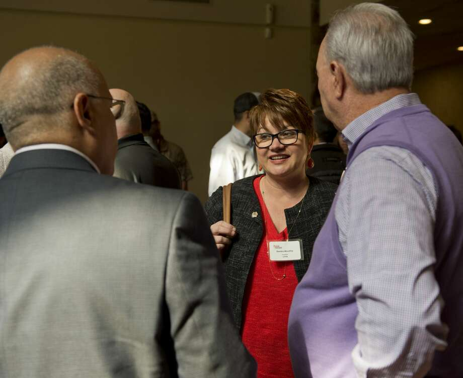 Sandra Woodley, president of UTPB, talks with Scott Williams, right, president of the Permian Basin Chapter of the American Association of Drilling Engineers and Ahmed Kamel, UTPB professor and advisor to the American Association of Drilling Engineers 03/13/18 before a luncheon at Green Tree Country Club where the chapter presented UTPB with $80,000 to purchase equipment for the new engineering program. Tim Fischer/Reporter-Telegram Photo: Tim Fischer/Midland Reporter-Telegram