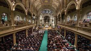 Large numbers of law enforcement and clergy were in attendance for the funeral mass for long time Albany Police Chaplin and honorary Assistant Chief Father James Lefebvre held at St. Mary's Church Tuesday March 13, 2018 Albany, N.Y. (Skip Dickstein/Times Union)