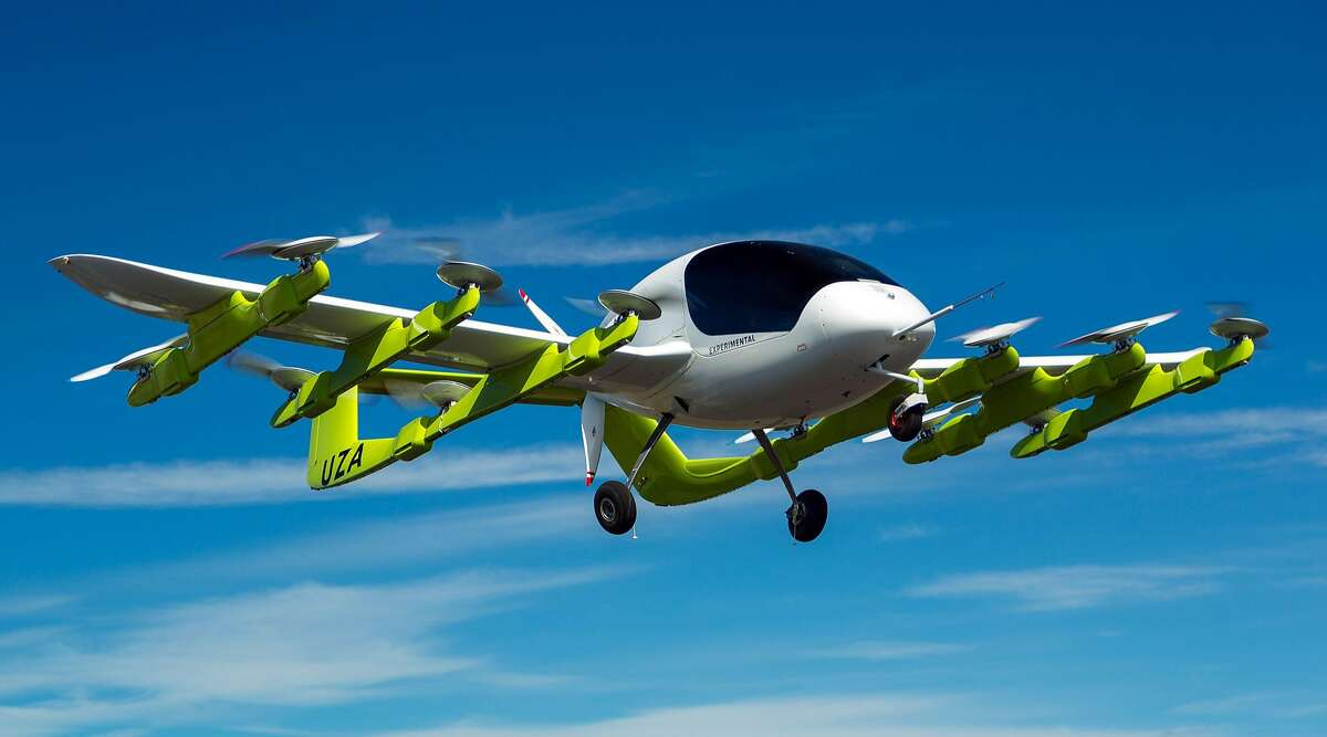 """In this handout picture received on March 13, 2018 from New Zealand based aviation company Zephyr Airworks shows a """"Cora"""" electric powered air taxi in flight. Self-piloted flying taxis are being tested in New Zealand as part of a project backed by Google co-founder Larry Page that supporters say will revolutionise personal transport. New Zealand regulators on March 13, 2018 approved plans for Zephyr Airworks, a subsidiary of Page's company Kitty Hawk, to develop and test the futuristic air taxis. KEEP CLICKING OR SWIPING TO SEE THE COST OF BAY AREA COMMUTES ===>  CREDIT Zephyr Airworks / RICHARD LORD/AFP/Getty Images"""
