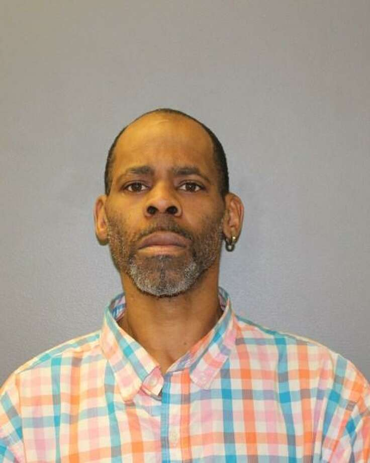 Mark Woods, 45, of New Haven, was arrested Monday after he allegedly pulled a knife while being stopped for shoplifting in Hamden. Photo: Photo Courtesy Of Hamden Police /