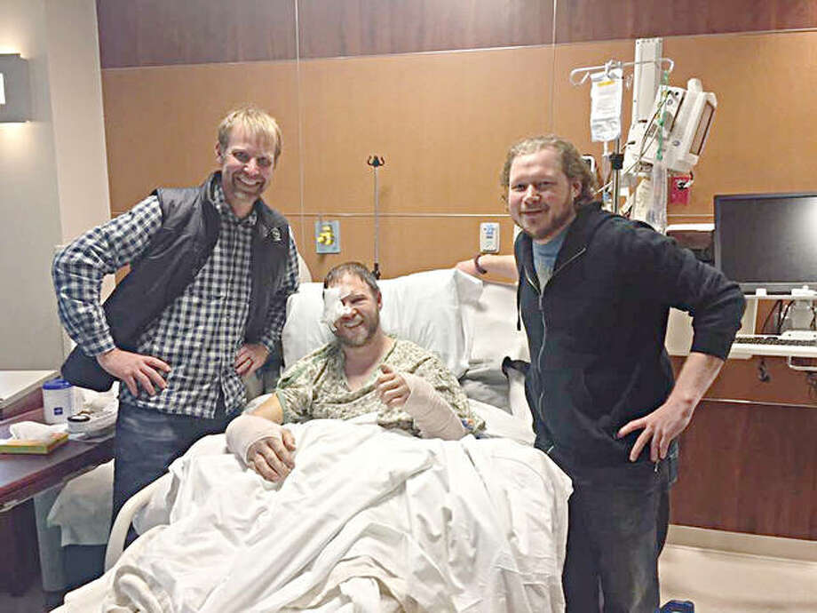 Rescuers Robert Rogers, an L&C alumnus, left, and Tyson Lockhart, right, visit with Adam Wright in the hospital. The pair rescued Wright after he took a 50-foot fall into the Gunnison River in western Colorado. Photo: For The Telegraph