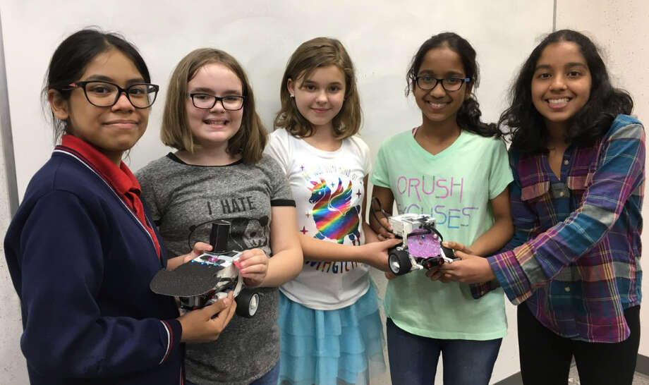 Girls in a Playbot Coding Club built Lego Mindstorms robots and then create a short video featuring their robots. Members of the Katy club, from left, are: Dayanara Garcia, Kyndslie Myers, Evy Priest, Mrinalini Jithendra and Namrata Jithendra. Photo: Karen Zurawski