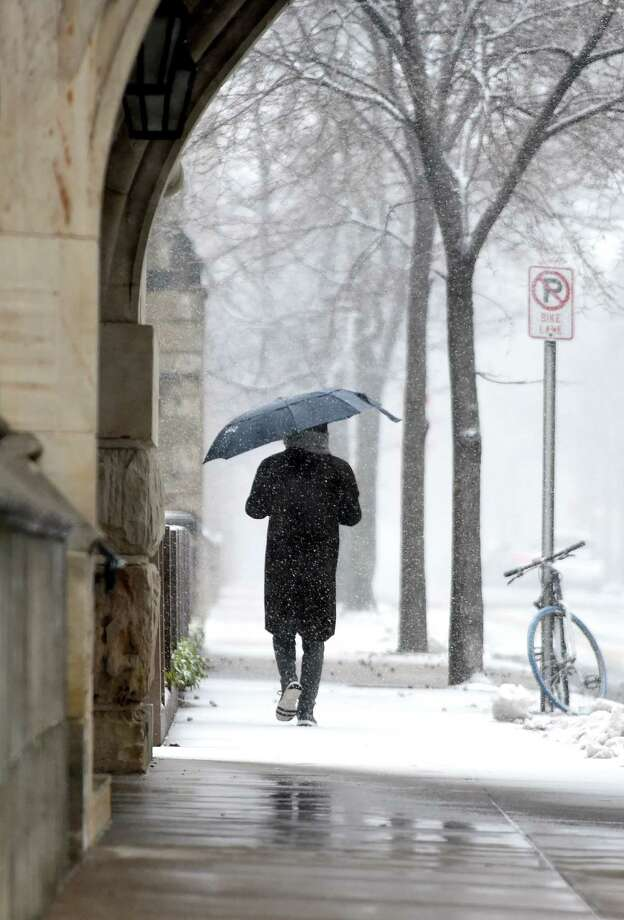 A man walks through the snow on High St. in New Haven on March 13, 2018. Photo: Arnold Gold, Hearst Connecticut Media / New Haven Register