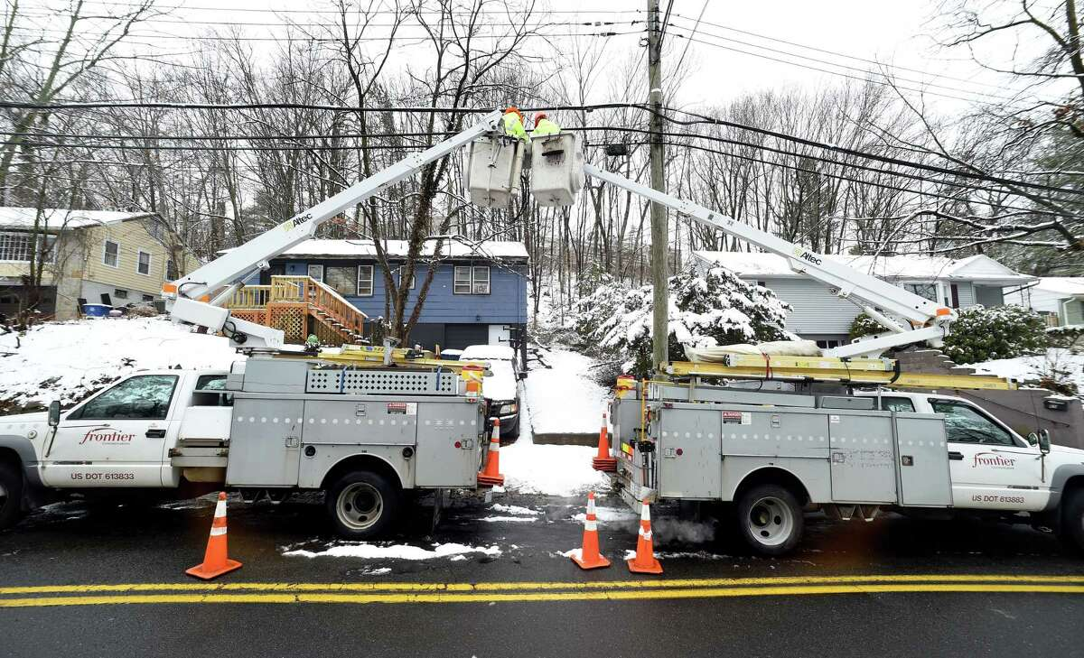 A Frontier Communications crew makes repairs on Marvelwood Drive in New Haven March 13, 2018.