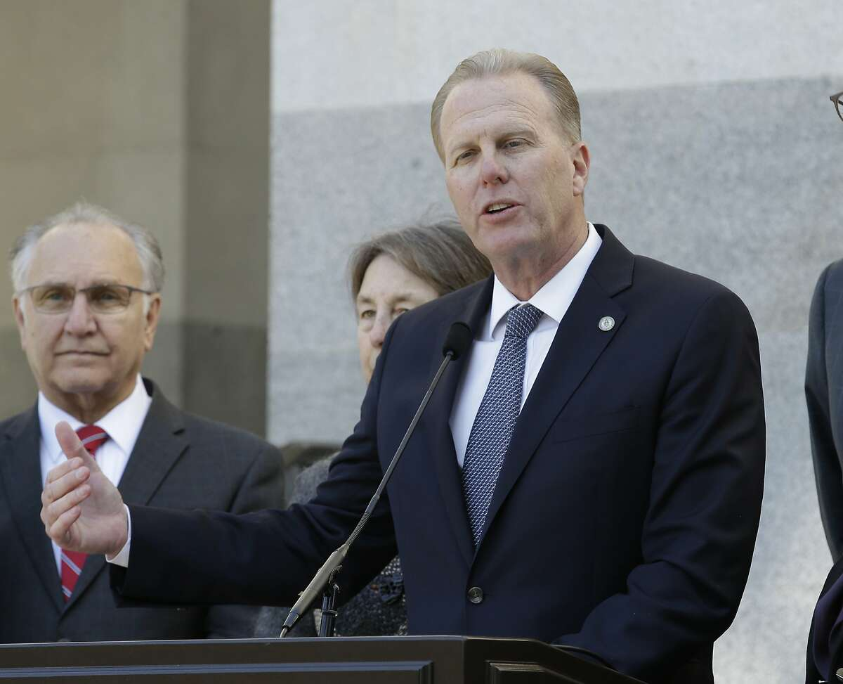 FILE - In this Feb. 21, 2018, file photo, San Diego Mayor Kevin Faulconer, center, discusses California's growing homeless crisis during a news conference in Sacramento, Calif. The Republican mayor criticized Trump's short visit to his town, saying the president won't get a full picture of the city. (AP Photo/Rich Pedroncelli, File)
