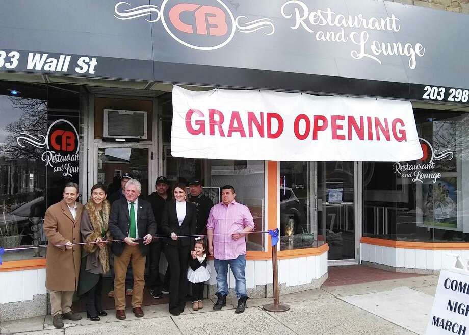 Diana Londono, center right, marks the grand opening of her CB Restaurant and Lounge on Saturday, March 10, 2018, at 83 Wall Street in Norwalk, Conn. On hand for a ceremonial ribbon cutting are Norwalk Mayor Harry Rilling, center left, along with (front L-R) state Sen. Bob Duff (D-Norwalk), Lucia Rilling and Sandro Rivera.