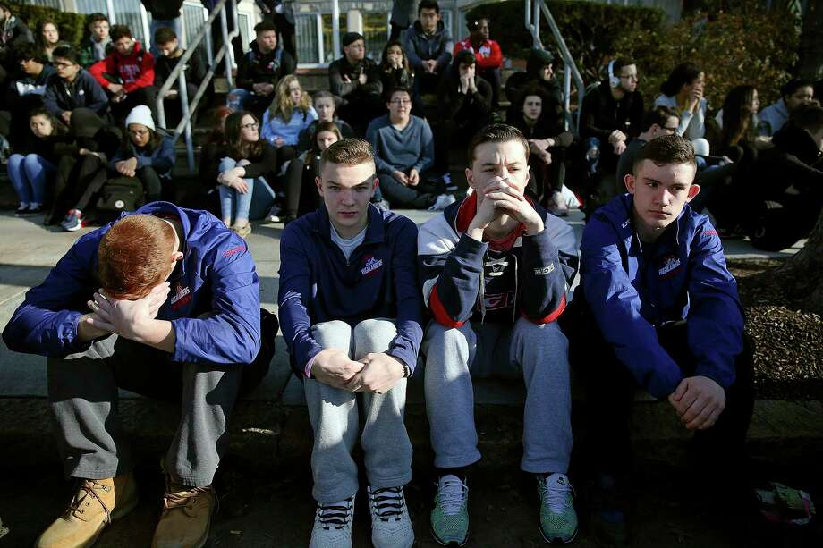 FILE - In this Feb. 28, 2018, file photo, Somerville High School students sit on the sidewalk on Highland Avenue during a student walkout at the school in Somerville, Mass. A large-scale, coordinated demonstration is planned for Wednesday, March 14, when organizers have called for a 17-minute school walkout nationwide to protest gun violence. (Craig F. Walker/The Boston Globe via AP, File) Photo: Craig F. Walker, AP / The Boston Globe
