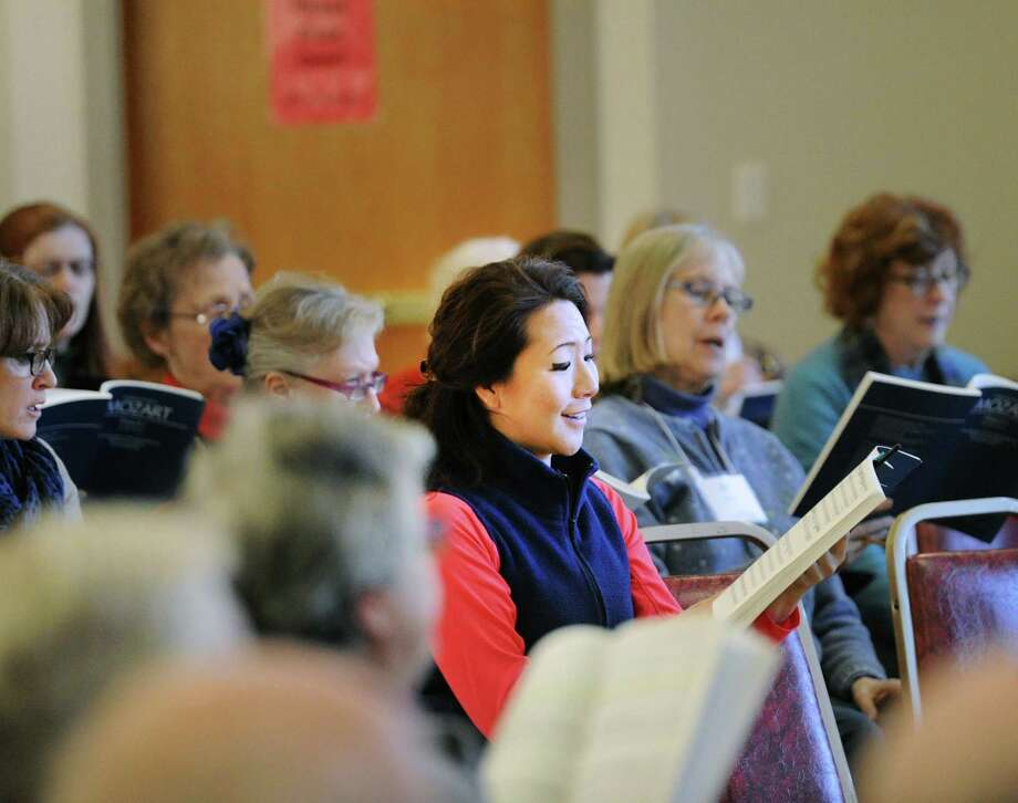 At center, Sarah Huo of Greenwich sings during the Greenwich Choral Society rehearsal at St. Paul's Episcopal Church in the Riverside section of Greenwich, Conn., for their upcoming Mystical Mozart performance at the GHS Performing Arts Center Saturday, March 17, at 4 p.m. Photo: Bob Luckey Jr. / Hearst Connecticut Media / Greenwich Time