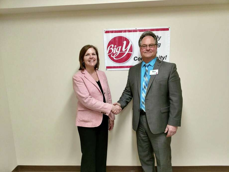 Dr. Denise Barajas, medical director of the Hewitt Center for Breast Wellness at Griffin Hospital, receives a $1,000 donation from Big Y manager Bob Rainville as part of Big Y's 11th Annual Partners of Hope Campaign. Photo: Contributed / Courtesy Of Griffin Hospital