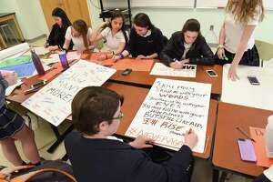 11th grader Emily Argoff, 16, bottom, finishes making a sign with a Maya Angelou quote as students make signs to prepare for tomorrow's National School Walkout at Albany Academy for Girls on Wednesday, March 14, 2018 in Albany, N.Y. (Lori Van Buren/Times Union)